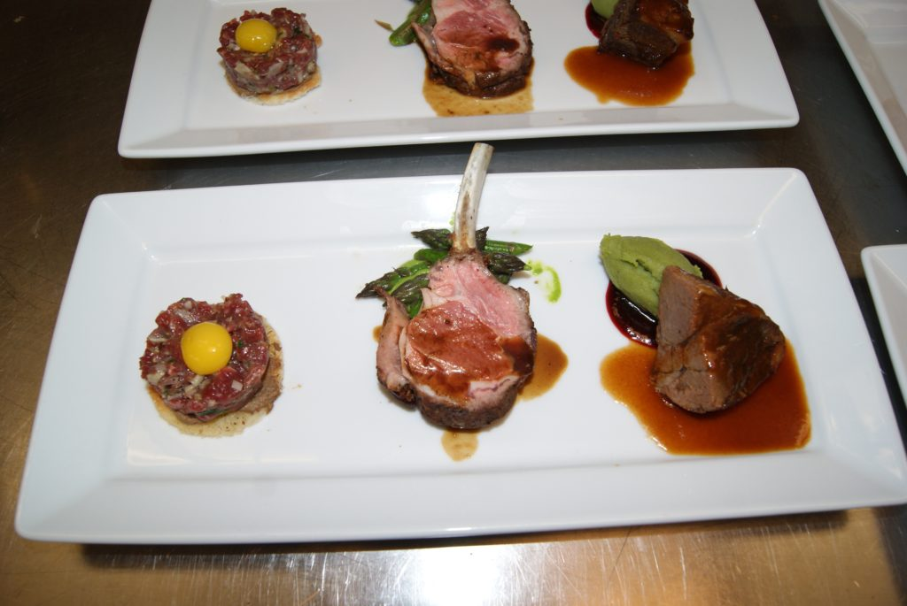Lamb rib chop featured on appetizer plate