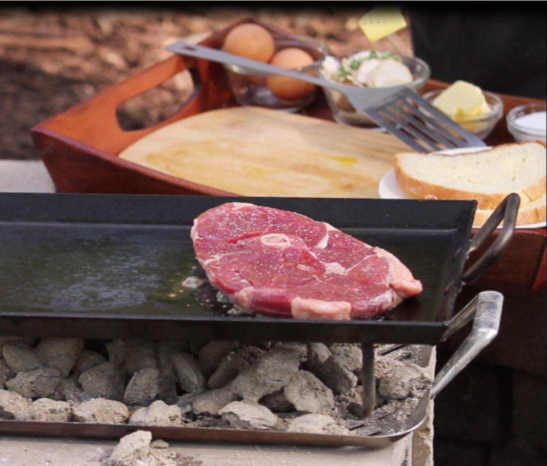 Lamb leg steak on grill