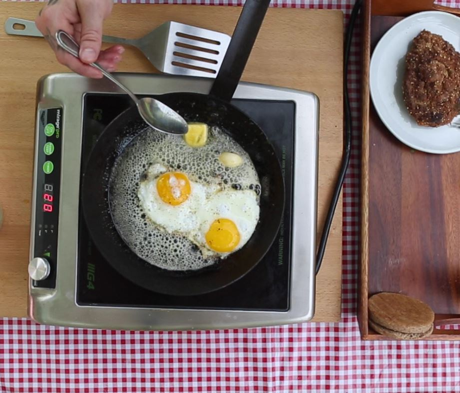 Fried eggs with herb butter