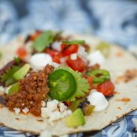 Goat Taco with Blackened Tomatoes