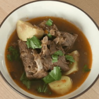 Nigerian style goat soup presented compr