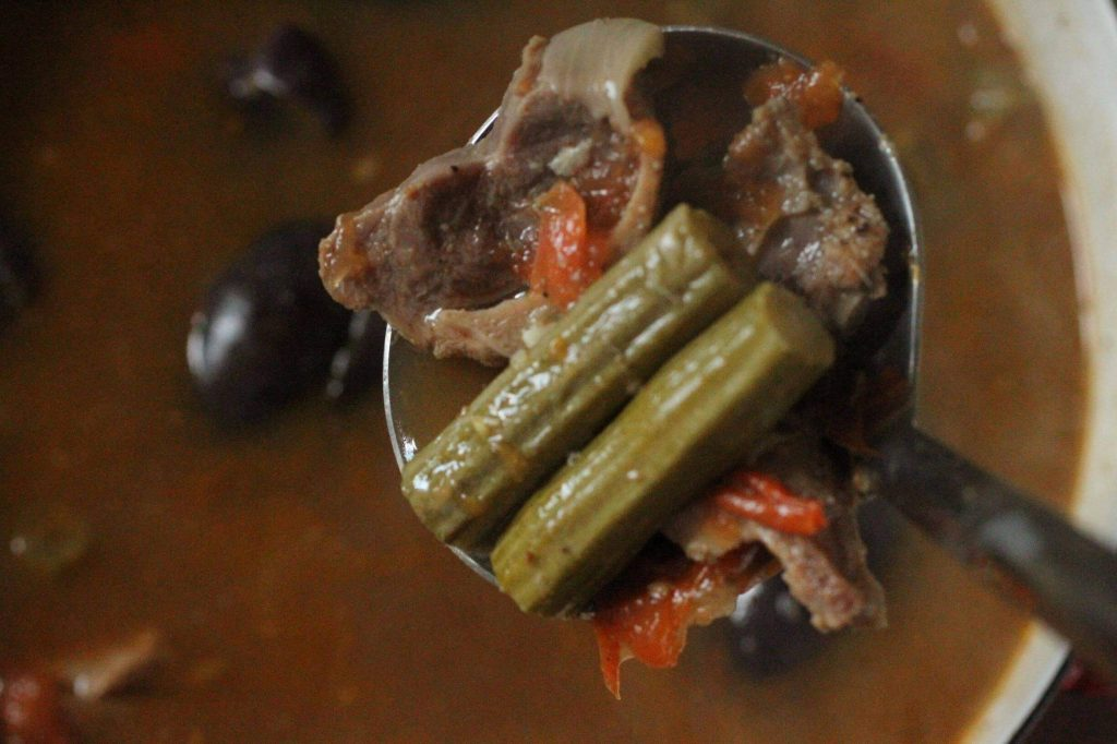 Moringa fruits and goat meat stew