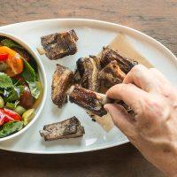Smoked lamb riblets with a tomato salad