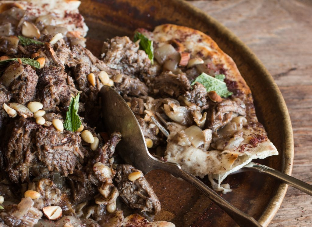 Lamb or goat mousakahn with sumac and onions
