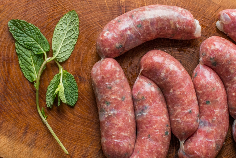 Grass fed lamb or goat sausage with fresh mint