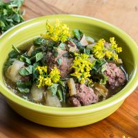 Grassfed lamb or goat meatball stew recipe with greens and fava beans