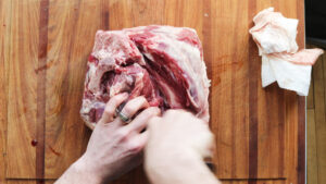Cutting a lamb leg into roasts