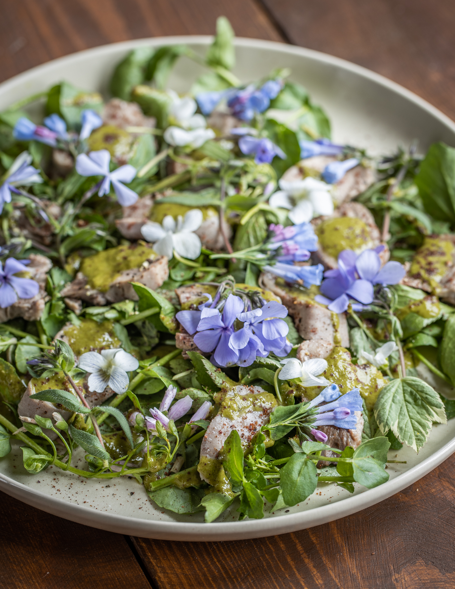 Goat tongue salad with salsa verde, fresh greens and wildflowers