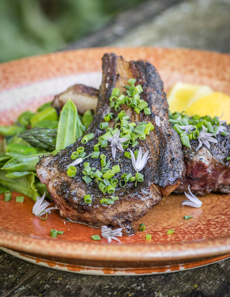 Black trumpet mushroom crusted goat chops with milkweed shoot and asparagus salad