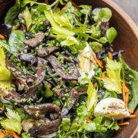 Salted lamb liver salad with balsamic vinegar and eggs